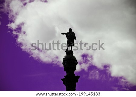 Statue of Christopher Columbus pointing America in Barcelona (Spain) over a cloudy sky - stock photo