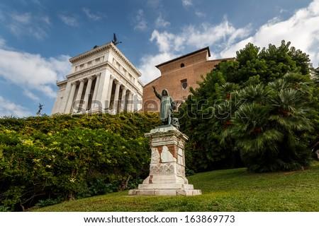 Statue of Cola di Rienzo and Santa Maria in Aracoeli Basilica on Capitoline Hill, Rome, Italy - stock photo