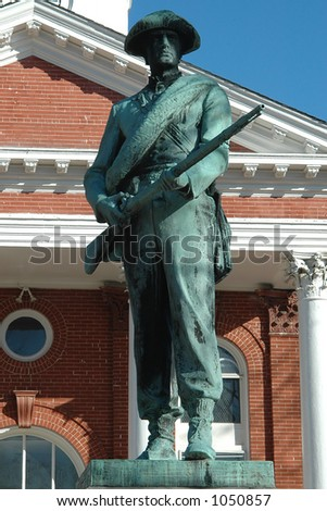 Statue of Confederate Soldier in front of Courthouse - stock photo