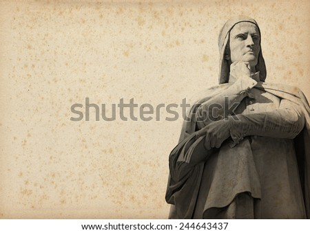 Statue of Dante Alighieri (1265-1321) father of the Italian language on yellowed paper with spots - stock photo