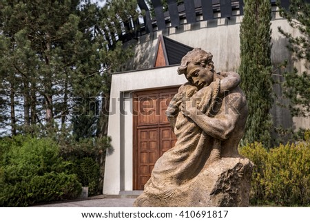 Statue of father and son hugging each other - stock photo