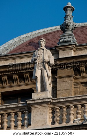 Statue of Gaetano Donizetti, on the toop of the facade of Opera House. - stock photo