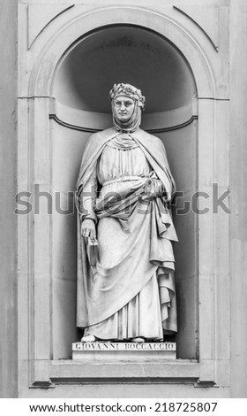Statue of Giovanni Boccaccio in the niches of the Uffizi Gallery colonnade, Florence. - stock photo