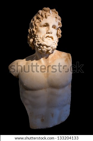 Statue of god Asclepius with selective lighting, black background - stock photo