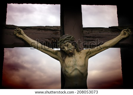 statue of Jesus against a moody sky - stock photo
