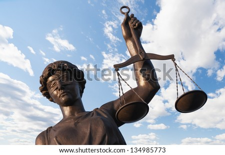 Statue of Justice on sky background - stock photo