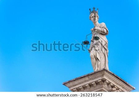 Statue of Justice, on the background of the sky - stock photo