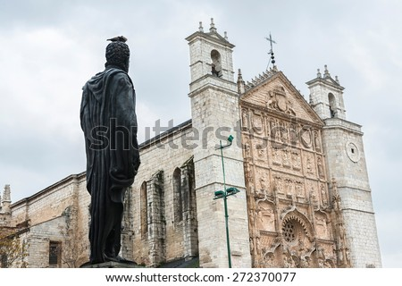 Statue of King Felipe II in San Pablo Square looking at the main facade of San Pablo Church, an Isabelline Gothic-Plateresque church built by Cardinal Juan de Torquemada between 1445 and 1468. - stock photo