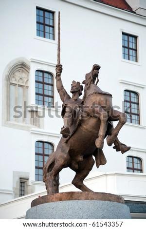 Statue of king Svatopluk in front of renewed Bratislava castle, Slovakia - stock photo