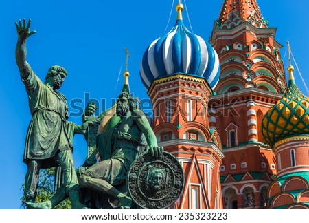 Statue of Kuzma Minin and Dmitry Pozharsky with Saint Basil's Cathedral on the background - stock photo