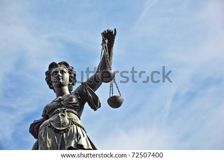 Statue of Lady Justice in front of the Romer in Frankfurt - Germany - stock photo