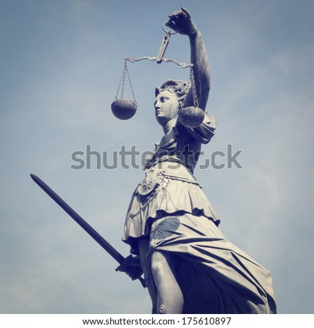 Statue of Lady Justice with retro effect - stock photo
