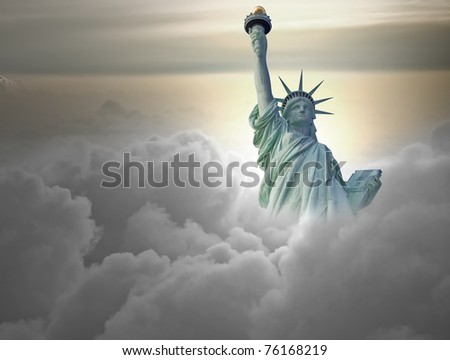 Statue of liberty above the clouds - stock photo