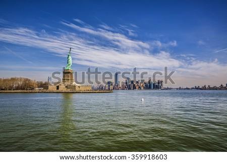 Statue of Liberty and Manhattan, New York - stock photo