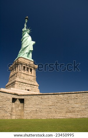 statue of liberty, clear blue sky, no people in picture - stock photo