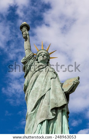 Statue of liberty in a beautiful summer day - stock photo