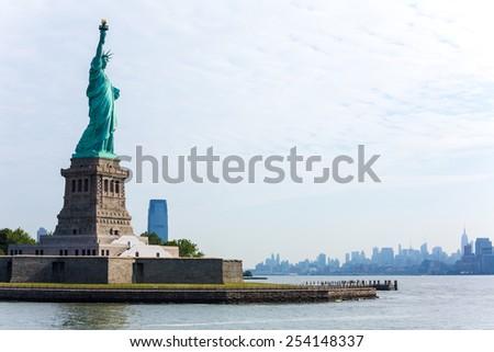 Statue of Liberty New York Manhattan background USA US - stock photo