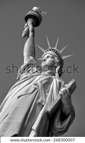 Statue of Liberty on Hudson River in NYC in black and white. - stock photo