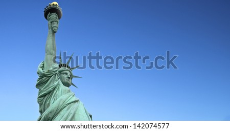 Statue of Liberty on isolated on blue sky - stock photo