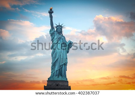 Statue of Liberty on the background of colorful dawn sky - stock photo