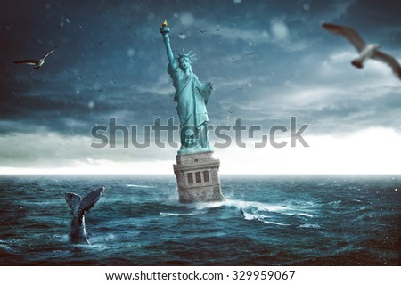 Statue of Liberty sinks in the ocean - stock photo