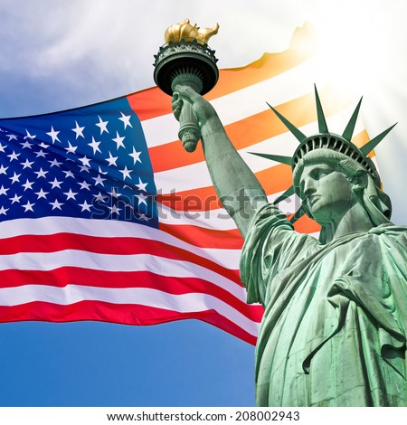 Statue of Liberty, sunny sky and USA flag background - stock photo