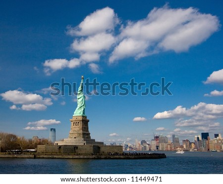 Statue of Liberty under Blue Sky with White Clouds, New York, United States of America - stock photo