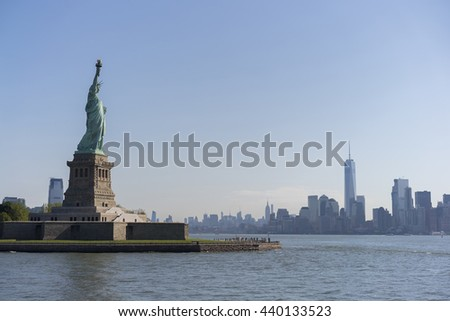Statue of Liberty with New York City in background - stock photo