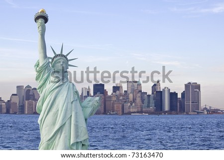 Statue of liberty with new york skyline in background - stock photo