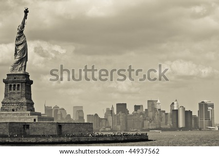 Statue of Liberty with Skyline of Manhattan - stock photo
