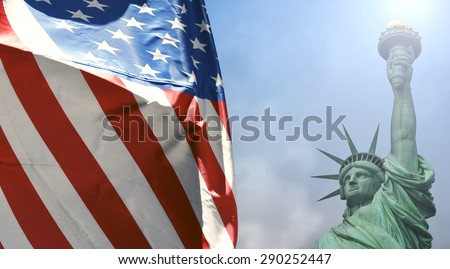 Statue of Liberty with the U.S. flag - stock photo