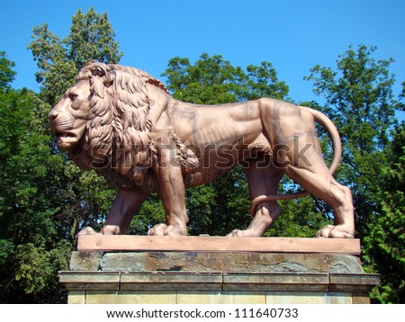 Statue of lion - guard the entrance - stock photo