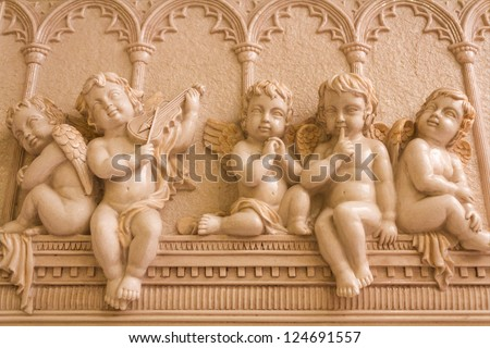 Statue of 5 little angels playing musical - stock photo