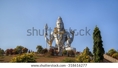 Statue of Lord Shiva in Murudeshwar, Karnataka, India. The demon Ravana gives Shiva lingam Ganesha in the form of the shepherd boy. - stock photo