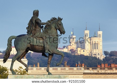 Statue of Louis and Basilique Fourviere on a background - stock photo