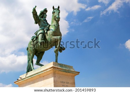 Statue of Louis XIV in Palace of Versailles - stock photo