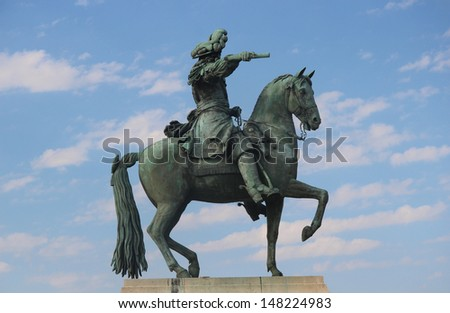 Statue of Louis XIV on horseback outside Palace of Versailles - stock photo