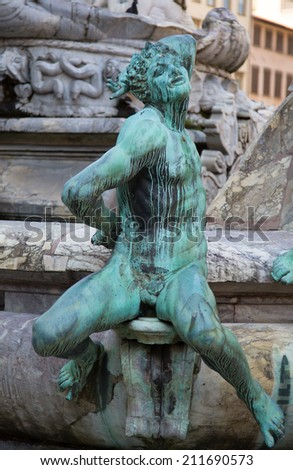 Statue of Neptune with towers in background, Piazza della Signoria, Florence Italy - stock photo