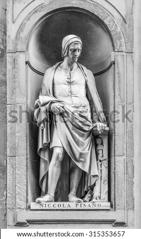 Statue of Niccola Pisano in the niches of the Uffizi Gallery colonnade, Florence. - stock photo