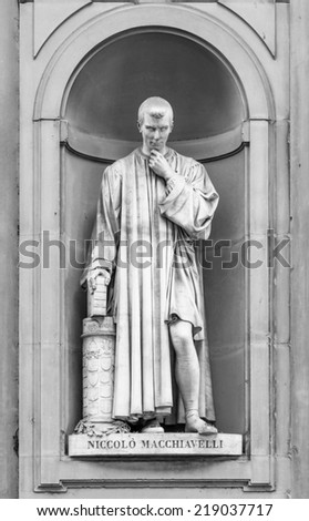 Statue of Niccolo Machiavelli in the niches of the Uffizi Gallery colonnade, Florence. - stock photo