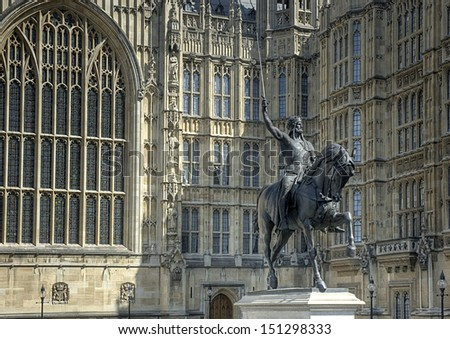 Statue of Richard the Lion Heart in front of the  parliament buildings in London, UK - stock photo