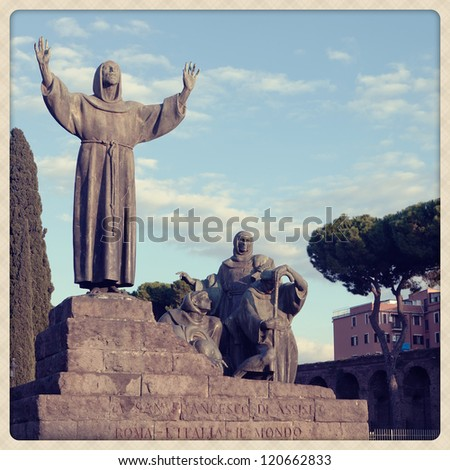 Statue of Saint Francis in Rome at Saint Jhon plaza. Shoot take with a mobile camera effect - stock photo