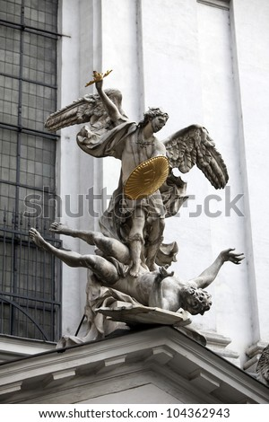 Statue of Saint Michael with gold shield and sword in center of Vienna, Austria - stock photo