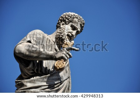 Statue of Saint Peter holding a key. Vatican city - stock photo