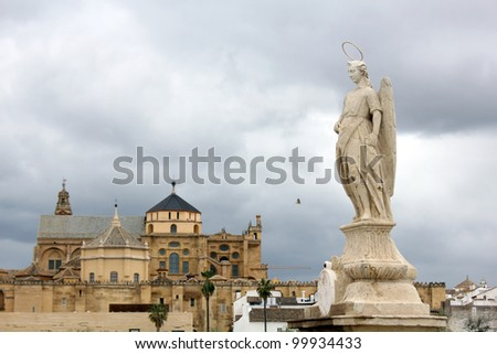 Statue of San Rafael in the Roman bridge and the cathedral mosque of Cordoba - Spain - stock photo