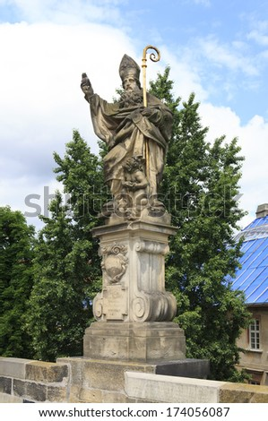 Statue of St. Augustine. Charles Bridge in Prague. Czech Republic. - stock photo