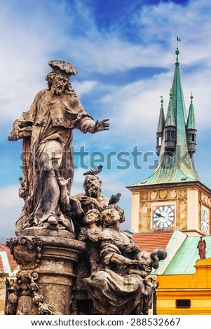 Statue of St. Ivo on Charles Bridge - stock photo