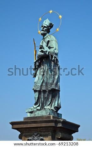 Statue of St. John of Nepomuk, Charles bridge, Prague - stock photo