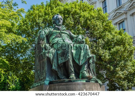 Statue of the famous German writer Johann Wolfgang von Goethe (designed by Edmund Hellmer, 1890) outside the Burggarten in downtown Vienna, Austria. - stock photo