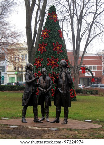Statue of the Marquis de Lafayette informing General George Washington and Colonel Alexander Hamilton that the French will support the Americans.  Located on the Morristown Green in New Jersey. - stock photo